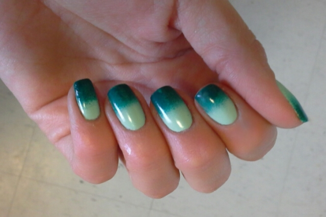 For this first design I made a gradient effect with a light minty green colour called Green With Envy by Maybelline and AMAZON...AMAZOFF by OPI. It looks really cool in person. I took these pictures on my iPad so they aren't the best quality.